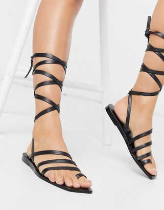ASOS DESIGN Freda leather minimal flat sandals in black
