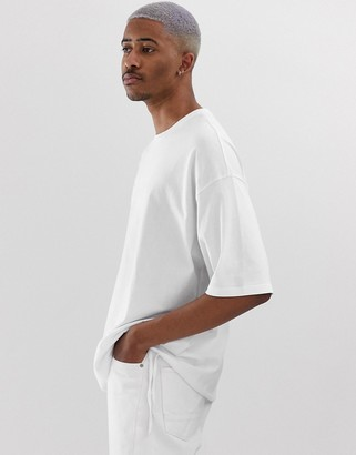 Asos Design DESIGN oversized t-shirt with drawstring hem in white