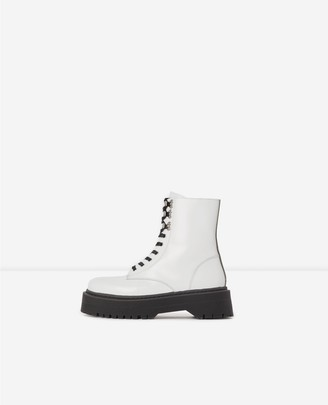 The Kooples Flat lace-up boots in glazed white leather