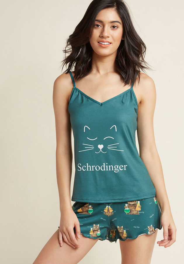 YMSP029ASC Tucked away in your room, all cozy in these pine green pajamas, you may or may not be snoozin'! The camisole top of this ModCloth-exclusive set showcases a simple nod to a feline-loving scientist, while the ruffle-edged shorts go all in with a quirky, gee