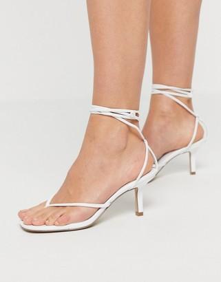 Steve Madden Lori tie leg toe thong mid heel sandals in white