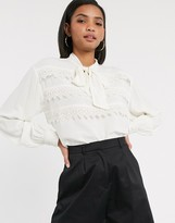 Vero Moda blouse with tie neck and crochet lace trim in cream