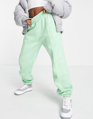 Nike mini swoosh oversized sweatpants in green