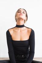 Donna Mizani Long Sleeve Cut Out Mock Top in Black