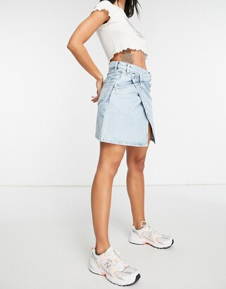 Monki Amalie organic cotton cross over denim mini skirt in bleach wash