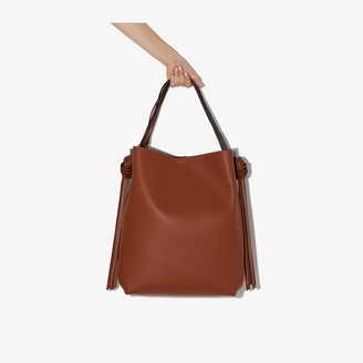 Neous black and brown Saturn leather tote bag