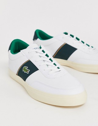 Lacoste Courtmaster sneakers with green side stripe in white leather