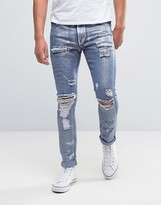 Asos Super Skinny Jeans With Mega Rips In Metalic Sliver Coated Blue