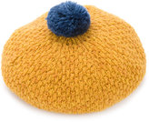 Familiar pom pom knitted beret