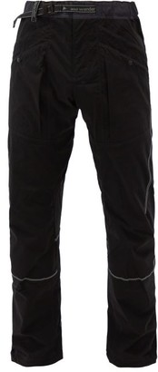 and wander Logo-print Shell Trousers - Black