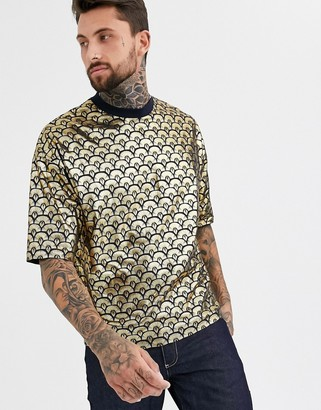 ASOS DESIGN oversized t-shirt in all over deco style gold foil print