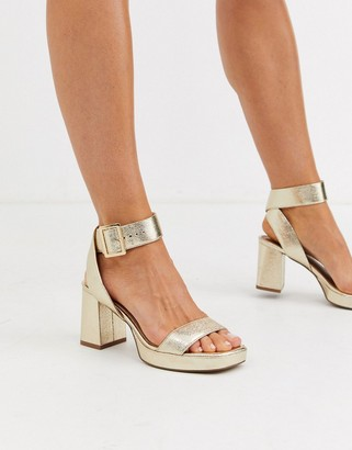 ASOS DESIGN Hopscotch platform heeled sandals in metallic