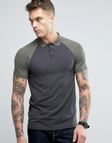 Asos Muscle Polo Shirt With Contrast Raglan In Washed Black And Green