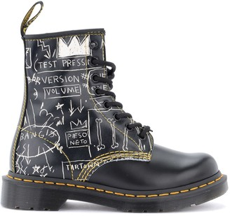 Dr. Martens 8-holes Combat Boot Model 1460 Basquiat Made Of Black Leather With White Graffiti