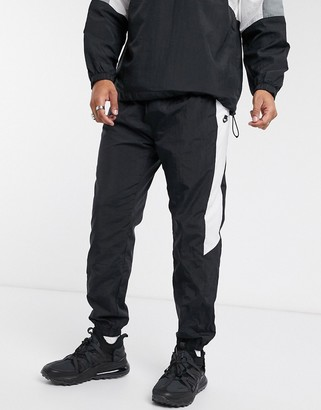 Nike color block woven cuffed sweatpants in black