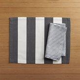 Crate & Barrel Olin Graphite Placemat and Liam Grey Stripe Linen Napkin