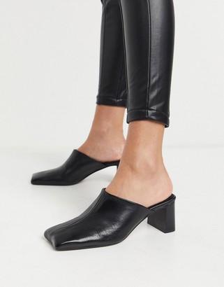 ASOS DESIGN Surreal premium leather mid-heeled mules in black