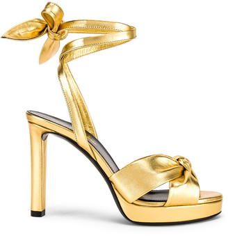 Saint Laurent Hall Bow Heel in Gold | FWRD