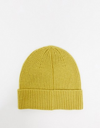 ASOS DESIGN fisherman rib beanie hat in recycled polyester in mustard
