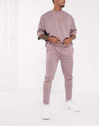 Asos Design DESIGN co-ord tapered joggers in scuba fabric with pin tucks & fixed hem in washed purple