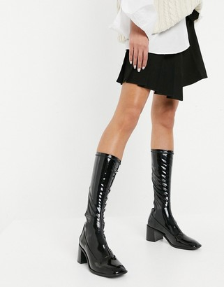 E8 by Miista Alisa high-rise leather heeled stretch boots in black