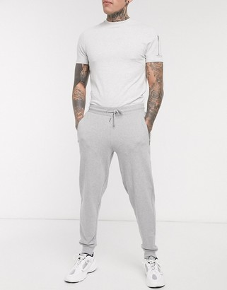 ASOS DESIGN organic tapered joggers in grey marl with silver zip pockets