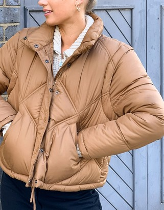 Only padded jacket with detachable sleeves in tan
