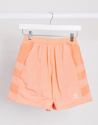adidas adicolor large logo shorts in coral