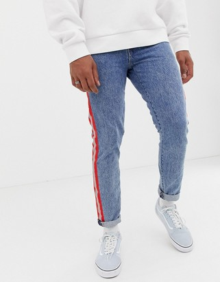 Levi's 512 reflective side tape slim tapered low riset jeans in acid light wash