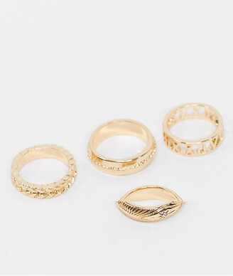 ASOS DESIGN pack of 4 rings in mixed texture and cut out roman numerals in gold tone