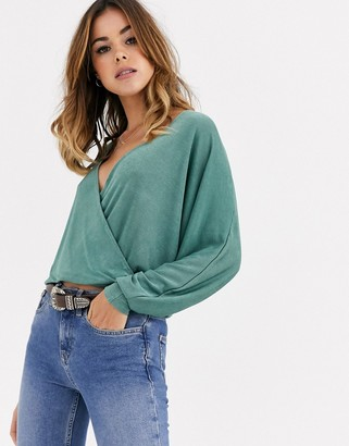 Asos DESIGN wrap top in slinky fabric with batwing sleeve in khaki