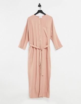 ASOS DESIGN slouchy button front tie waist jumpsuit in linen