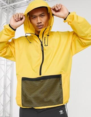 adidas adventure windbreaker jacket in gold