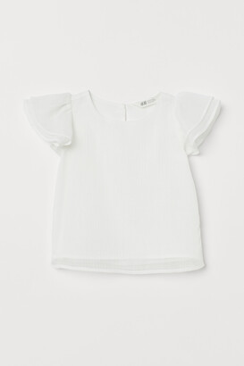 H&M Shimmering blouse