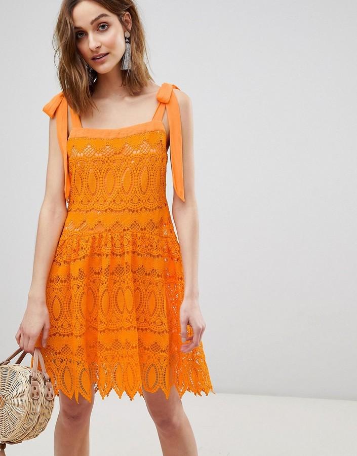 Vero Moda all over lace cami mini dress with tie straps in orange