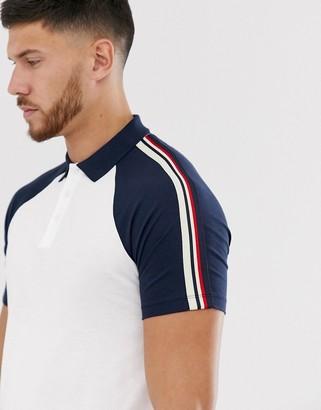 Asos Design DESIGN organic raglan polo shirt with shoulder taping in white