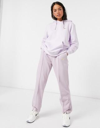 Nike mini metallic swoosh oversized pastel purple hoodie