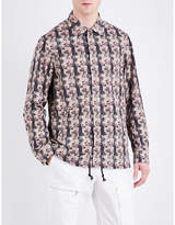 Undercover Distorted face-print shell jacket