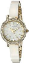 Anne Klein Women's AK/2180IVGB Swarovski Crystal Accented Gold-Tone and Ivory Ceramic Bangle Watch