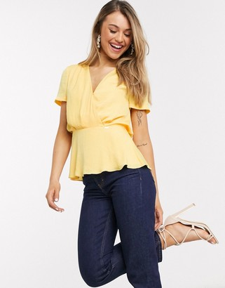 Morgan wrap front ruffle hem blouse in yellow