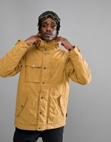 Jack Wolfskin Fort Nelson Jacket In Tan With Tartan Lined Hood