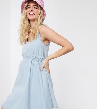 ASOS DESIGN Maternity soft denim scoop neck skater dress in lightwash blue