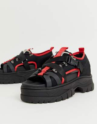Asos Design DESIGN sneaker sandals in black and red with chunky sole
