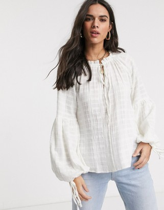 Asos DESIGN long sleeve textured smock top with high neck in white