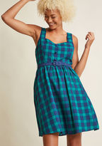 FA17MCD1411 Keeping a casual pace, you breeze through the city center atop your bike in this adorable A-line dress. Part of our ModCloth namesake label, this green-and-navy, updated gingham frock features pockets and a sleek belt, so while you revel in the architectu