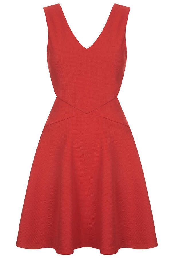 Topshop Throw shapes in this fit and flare skater dress. crafted from soft textured jersey with cut-away detail to the sides, a v-neck and back, and back zip fastening. 96% polyester, 4% elastane. machine washable.