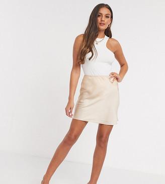 ASOS DESIGN Petite mini satin slip skirt in bone
