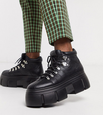 Asos DESIGN Wide Fit lace up boots in black faux leather with chunky sole