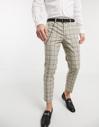 Twisted Tailor tapered trousers with chain in stone check