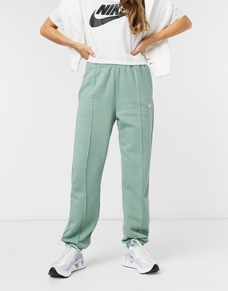 Nike mini metallic swoosh oversized pastel green track pants